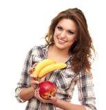Holding a apple and banana. Beautiful girl isolated on white background holding a apple and banana Royalty Free Stock Photo