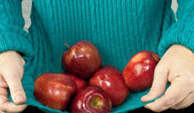 Holding Apples In Shirt Stock Photography