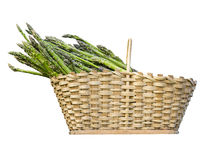 Holding an asparagus. Placing a healthy asparagus in the basket Royalty Free Stock Images