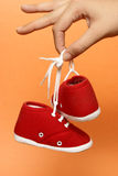 Holding Baby Shoes Stock Images
