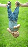 Holding baby upside Stock Photography