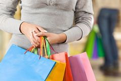 Holding bags Royalty Free Stock Photos