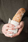 Holding a baguette Stock Photo