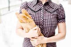 Woman with baguettes Royalty Free Stock Images