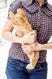 Woman hands holding baguettes Stock Images