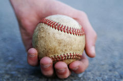 Holding the ball. A man holding his baseball with a firm grip stock photography