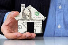 Holding banknote house icon Royalty Free Stock Photos