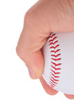 Holding a baseball. A hand holding a white baseball with red stitching. Add your text to the background Royalty Free Stock Photos