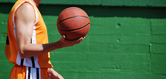 Holding a Basket ball Stock Photo