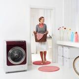 Holding basket of laundry Stock Photo