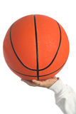 Holding basketball Royalty Free Stock Image