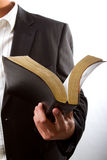 Holding Bible. A man reading from the holy bible Stock Photography
