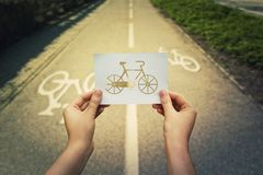 Holding bicycle icon stock image
