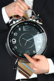 Holding big clock Stock Images