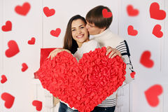 Holding a big heart Royalty Free Stock Image