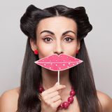 Holding big pink lips sign stock photos