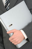 Holding a Binder. Businessman Holding a Binder - close-up Stock Images