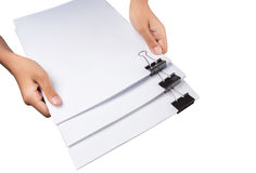 Holding Binder Clips And White Paper V Royalty Free Stock Photos