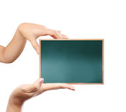 Holding a blank blackboard Stock Photo