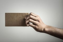 Holding blank brown card Stock Photos