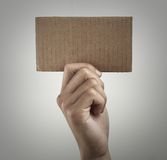 Holding blank brown card Royalty Free Stock Photography