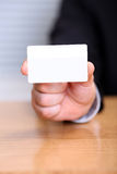 Holding a blank business card Royalty Free Stock Images