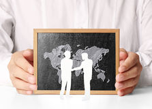 Holding blank chalkboard in  hand Stock Photography