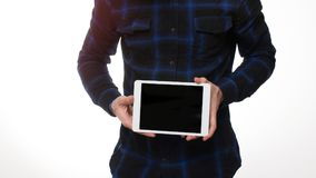 Young man with a tablet pc in the studio. Holding blank digital tablet with copy space Royalty Free Stock Photography