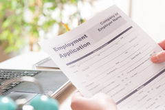 Holding blank employment application form Stock Photography