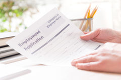 Holding blank employment application form Stock Photo