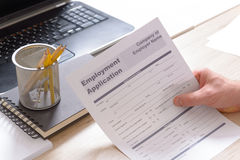 Holding blank employment application form Royalty Free Stock Images
