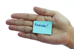 Holding blank notepaper with reminder. Woman hand holding blank notepaper with reminder on pure white background Stock Photo
