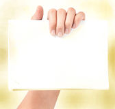 Hand holding blank paper isolated Stock Photography