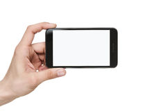 Holding blank smart phone with clipping path. Human hand holding blank mobile smart phone with clipping path for the screen Stock Photography
