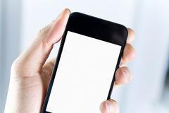 Holding Blank Smartphone. A man holding smartphone with blank screen in hand. Closeup shot Stock Photo