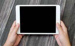 Holding blank tablet device Stock Photography