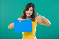 Holding a blue paper Royalty Free Stock Images
