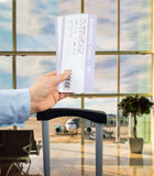 Holding Boarding Pass at the airport Stock Photos