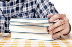 Holding the book Stock Images