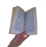 Holding a book open. Hand holding a book Royalty Free Stock Image