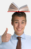 Holding books over his head. Royalty Free Stock Images