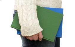 Holding books by your side. Person carrying books by their side Royalty Free Stock Photography