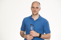 Holding a botle of water stock photography