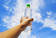 Holding bottle and sky Royalty Free Stock Images