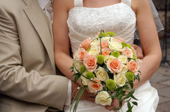 Holding Bouquet. Bride Holding Bouquet from rose - pinkly yellow Royalty Free Stock Photography