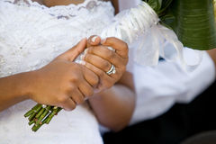 Holding the bouquet. An African-American bride holding her bouquet after the wedding ceremony Stock Images