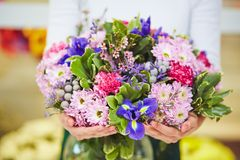 Holding bouquet Royalty Free Stock Image