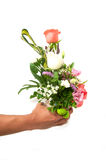 Holding bouquet of flowers Stock Photo