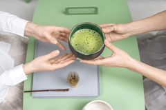 Holding bowl with green matcha tea Stock Images