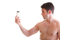 Holding a boxes with supplements on his biceps Stock Images